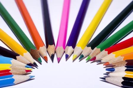 many colour pensils on white background photo
