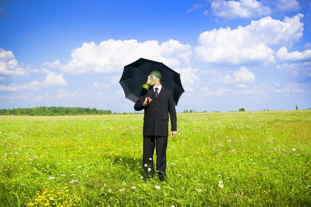 man in gas-mask on meadow Conceptual composition photo