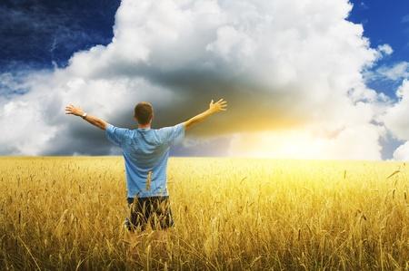 Man in yellow wheat meadow  Conceptual design  Stock Photo