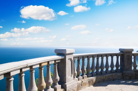 banister: Kind on ocean from a stone balcony