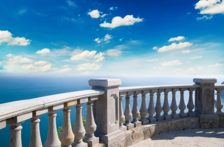 Kind on ocean from a stone balcony Stock Photo - 13842056