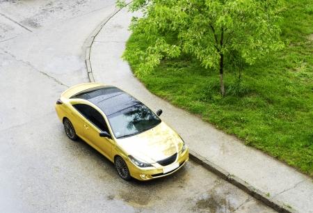 Golden sportcar on the street