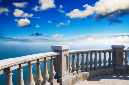 Kind on ocean from a stone balcony Stock Photo - 14577010