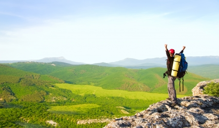 Man on top of mountain. Conceptual design. Stock Photo