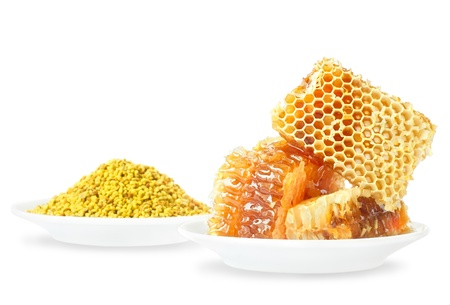 Honey honeycombs and pollen on plates on a white background Stock Photo - 16508741