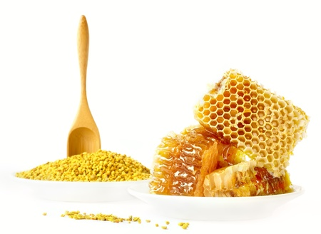Honey honeycombs and pollen on plates on a white background Stock Photo - 17732130