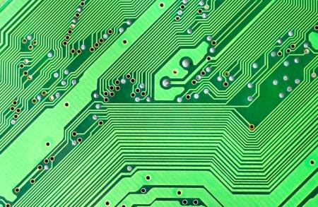 Electronic microcircuit taken closeup as background photo