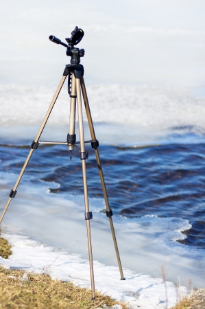 Support of the photographer on icy river photo