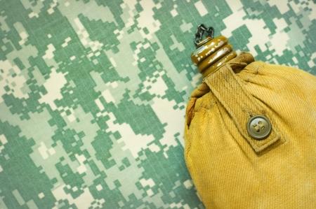 acu: Yellow tourist flask on a ACU camouflage background