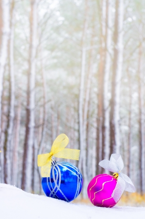 Christmas toys on snow in winter wood photo