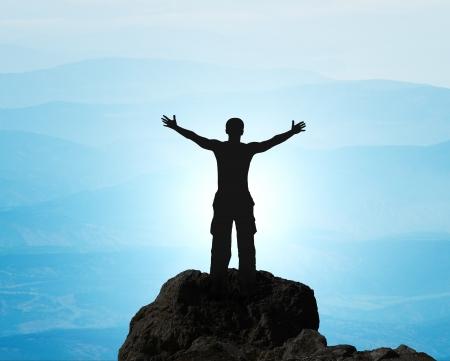 Man on top of mountain  Conceptual design  Stock Photo