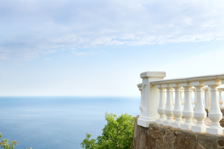 Kind on ocean from a stone balcony Stock Photo - 20554014