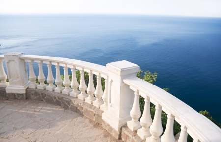 Kind on ocean from a stone balcony Stock Photo - 20827374