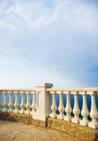 Kind on ocean from a stone balcony Stock Photo - 21729274