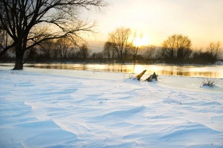 frozen river: Sunset over frozen river in winter