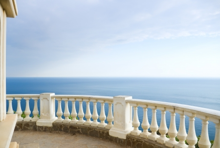 Kind on ocean from a stone balcony Stock Photo - 21729347