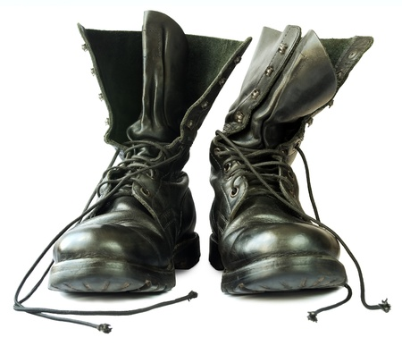 Military style black leather boots on white background  photo