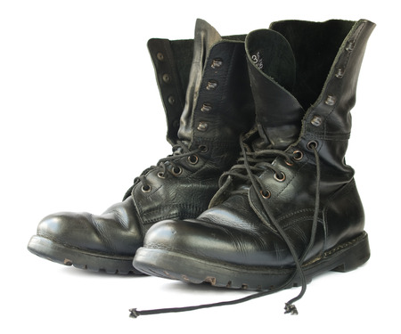 army boots: Military style black leather boots on white background  Stock Photo