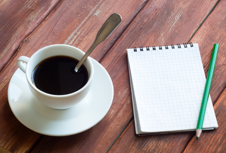 Coffee Espresso. Cup Of Coffee and Open notebook photo