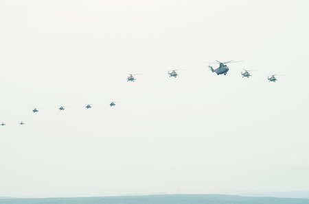 Flight of aircraft in the sky, a group of military helicopters. May 2014. Crimea. photo