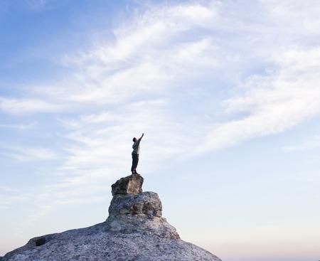free climbing: Man on top of mountain. Conceptual scene.