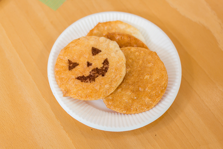 soysauce: enjoy with halloween senbei on  paper plate