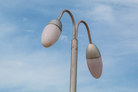 lamp on the pole: lamp pole  and  blue sky background