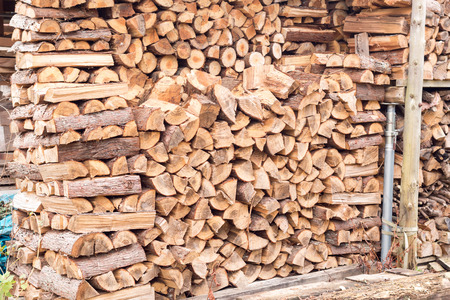 stack of firewood: stack of firewood for winter in front house Stock Photo
