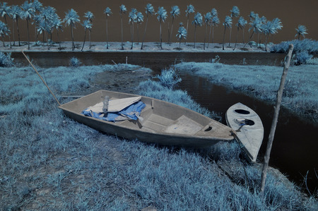 A boat and canoe kayak in infrared photography. Stock Photo