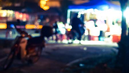 Blur photo of hawker at night.