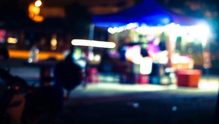 hawker: Blur photo of hawker at night.