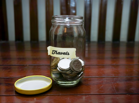 Saving Money Concept With Travel Text Written Label At Glass Jar. Stock Photo