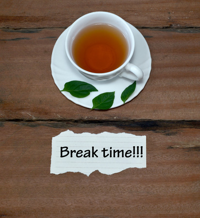 Cup Of Tea With Text Break Time On Wood Background.Concept Photo Stock Photo