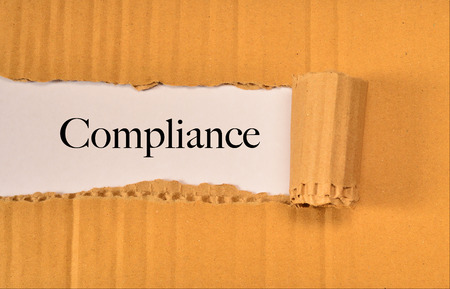 Torn Paper With Word Compliance. Stock Photo