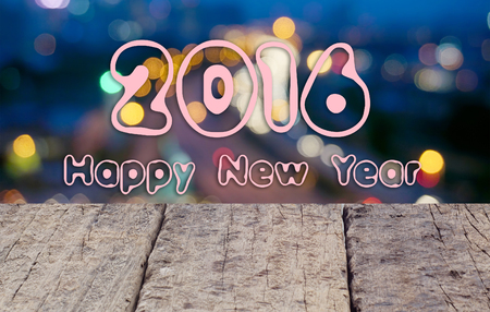 Happy New Year 2016 Text.With Wooden Desk And Abstract Blur Bokeh Background.
