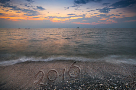 Happy new year 2016 creative on beach,sunset,Australia.
