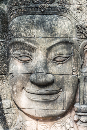 asian art: Stone carving of a human face. Asian Art