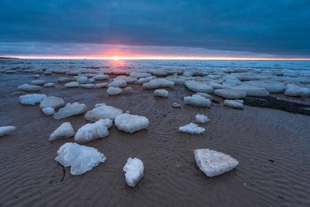 ice on sunset beach photo