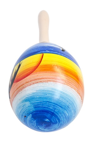 sounds: colorful wooden rattle. macro. isolated. white background. Stock Photo