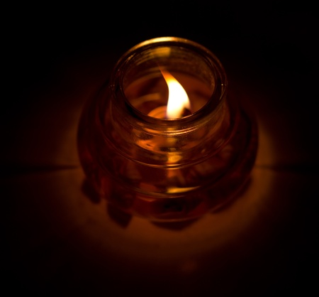candle is lit in the dark. macro Stock Photo