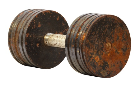 circular muscle: old rusty dumbbell on a white background Stock Photo