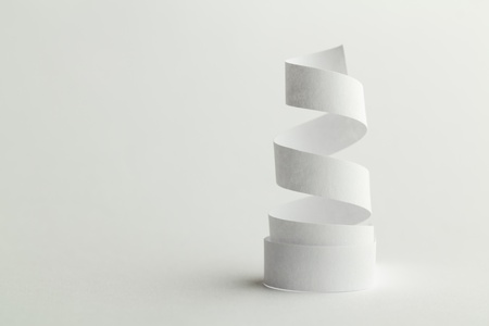 white paper spiral on a white background photo