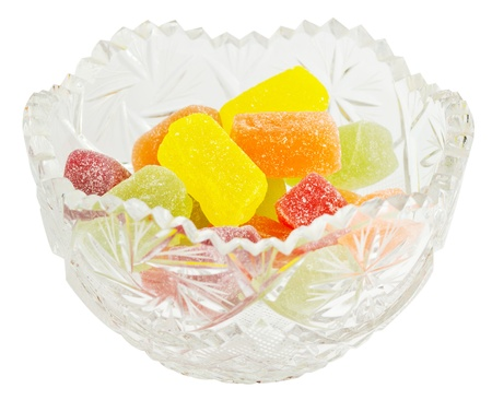 Crystal vase with jelly candies on a white background Stock Photo