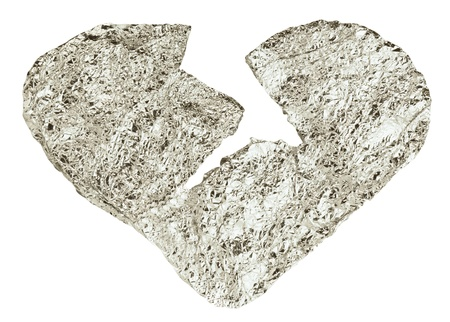 a broken heart from a foil on a white background Stock Photo - 11577469