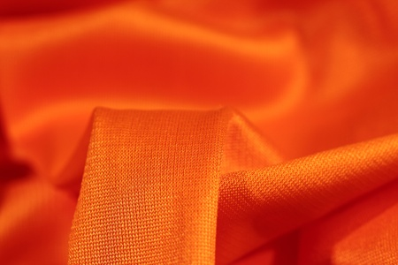 background of orange fabric closeup photo