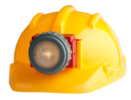 construction helmet with a flashlight on a white backgound