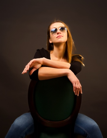 sexy girl sitting on a chair Stock Photo