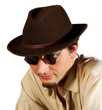 portrait of a guy in sunglasses and a hat on a white background
