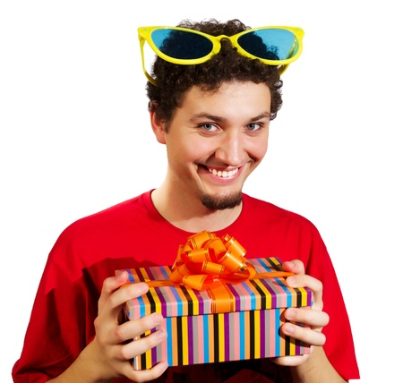 funny guy holding a gift in the hands of