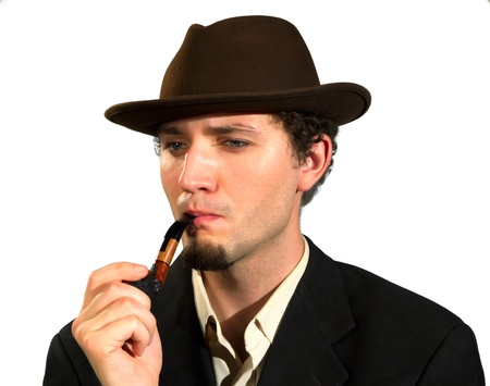 A young man smoking a pipe on a white background